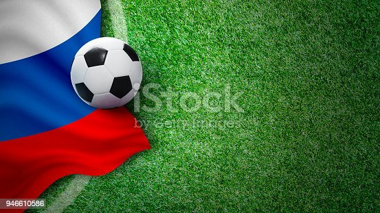 istock Soccer ball and russia flag on green grass in stadium with copy space 946610586