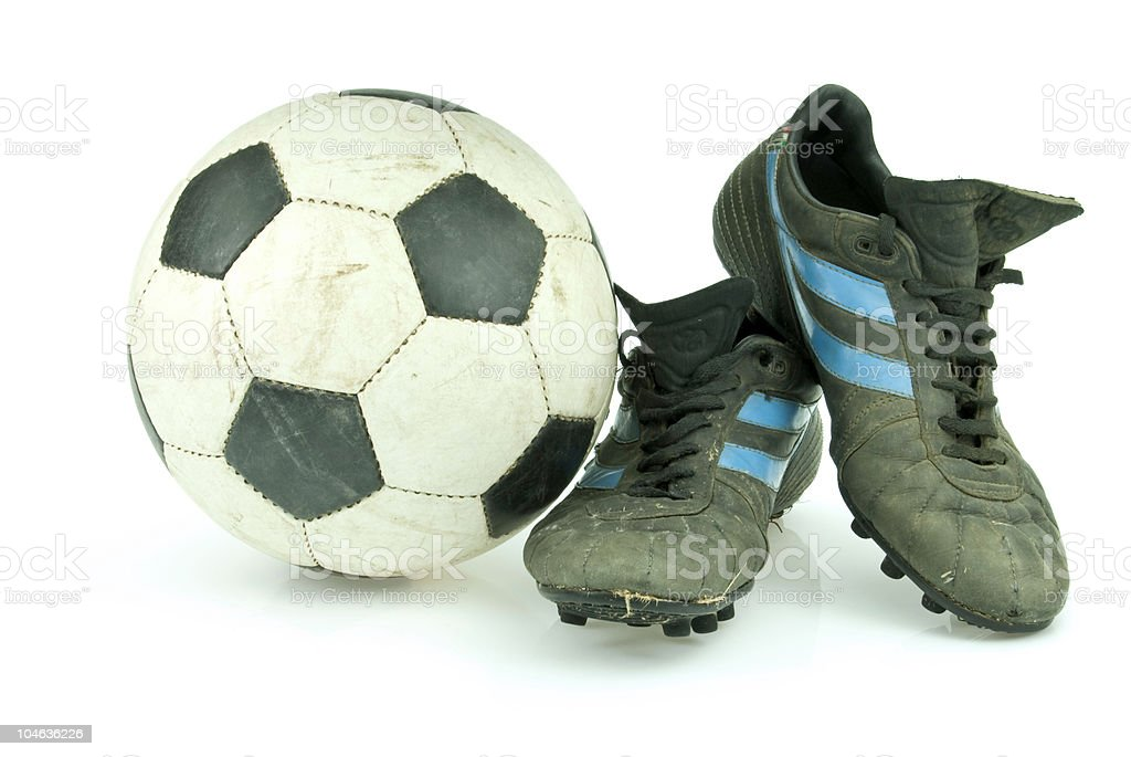Soccer ball and vintage cleats royalty-free stock photo