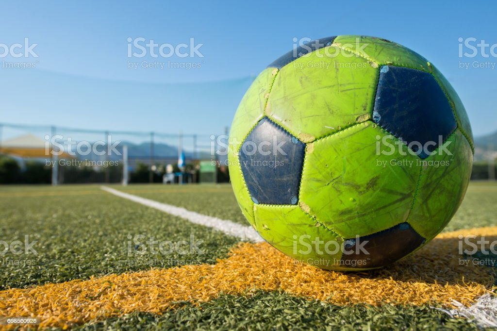 Soccer ball at the center of the field stock photo