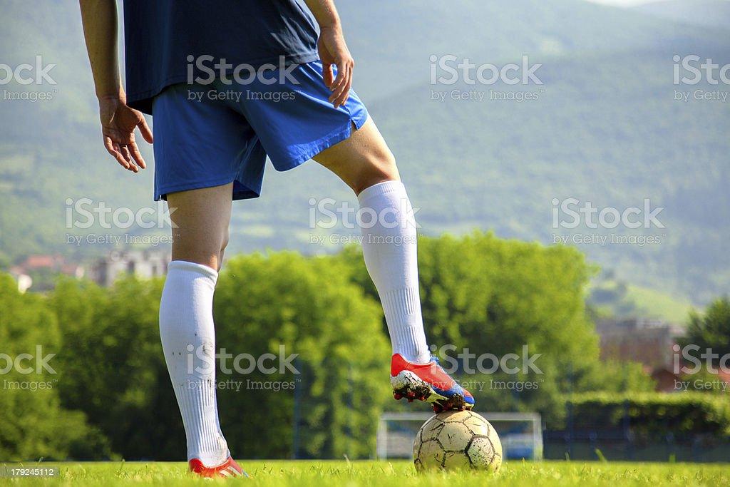 Soccer ball at the kickoff of a game royalty-free stock photo