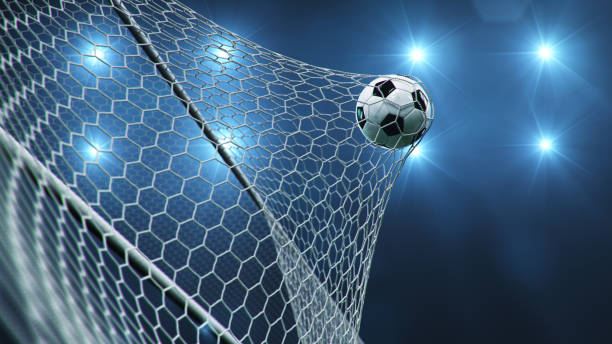 Soccer ball flew into the goal. Soccer ball bends the net, against the background of flashes of light. Soccer ball in goal net on blue background. A moment of delight. 3D illustration Soccer ball flew into the goal. Soccer ball bends the net, against the background of flashes of light. Soccer ball in goal net on blue background. A moment of delight, 3D illustration netting stock pictures, royalty-free photos & images