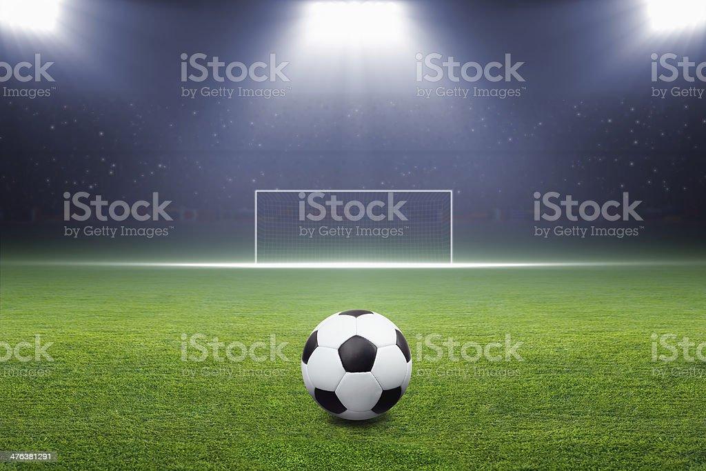 Soccer ball, goal, spotlight royalty-free stock photo