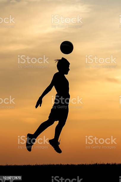 Soccer ball header at sunset picture id1019777870?b=1&k=6&m=1019777870&s=612x612&h=y4yzyn3elaxh8uofh5xanlvjwteh gbiuwmgr4mihju=