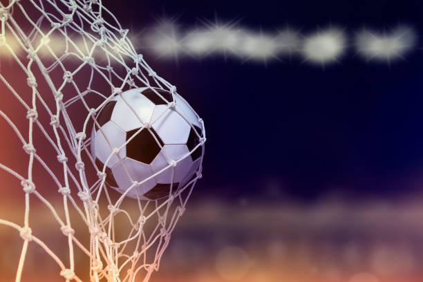 Soccer ball hit the net,success goal concept on stadium Soccer ball hit the net,success goal concept on stadium american football ball stock pictures, royalty-free photos & images