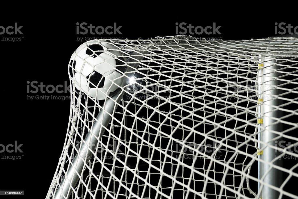 Soccer ball hits the net at stadium royalty-free stock photo