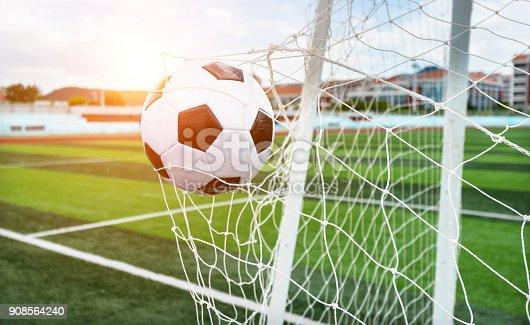 istock Soccer ball hitting the net 908564240
