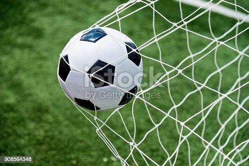 istock Soccer ball hitting the net 908564348