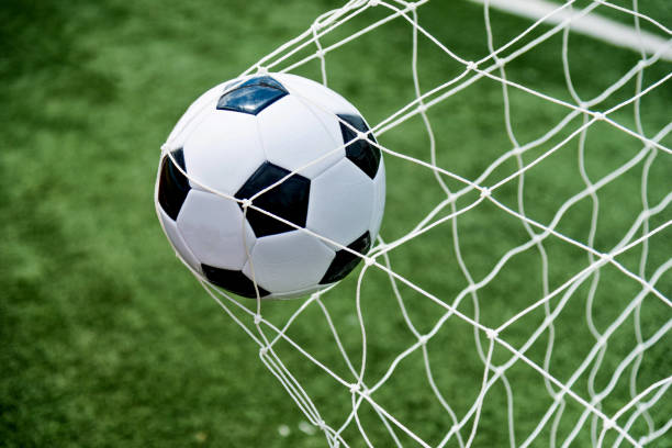 The Soccer Ball Hit Into The Net: Best Scoring A Goal Stock Photos, Pictures & Royalty-Free