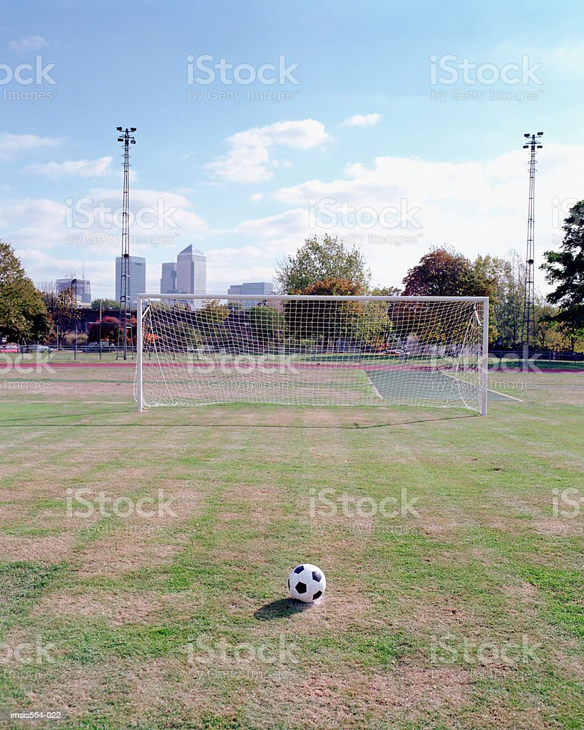 Soccer ball in field royalty-free stock photo