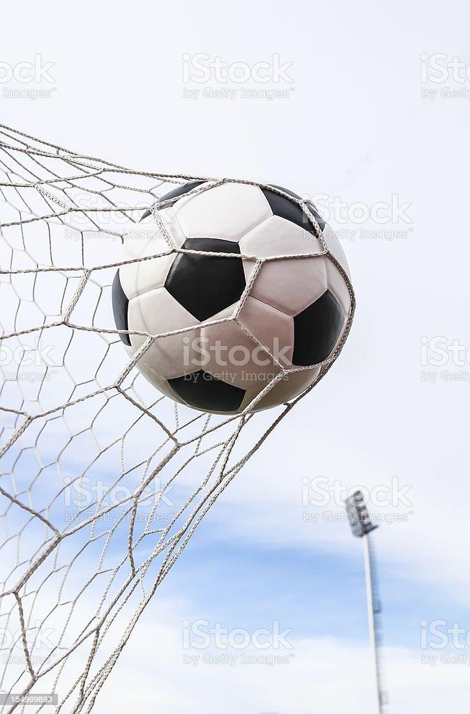 soccer ball in goal net royalty-free stock photo