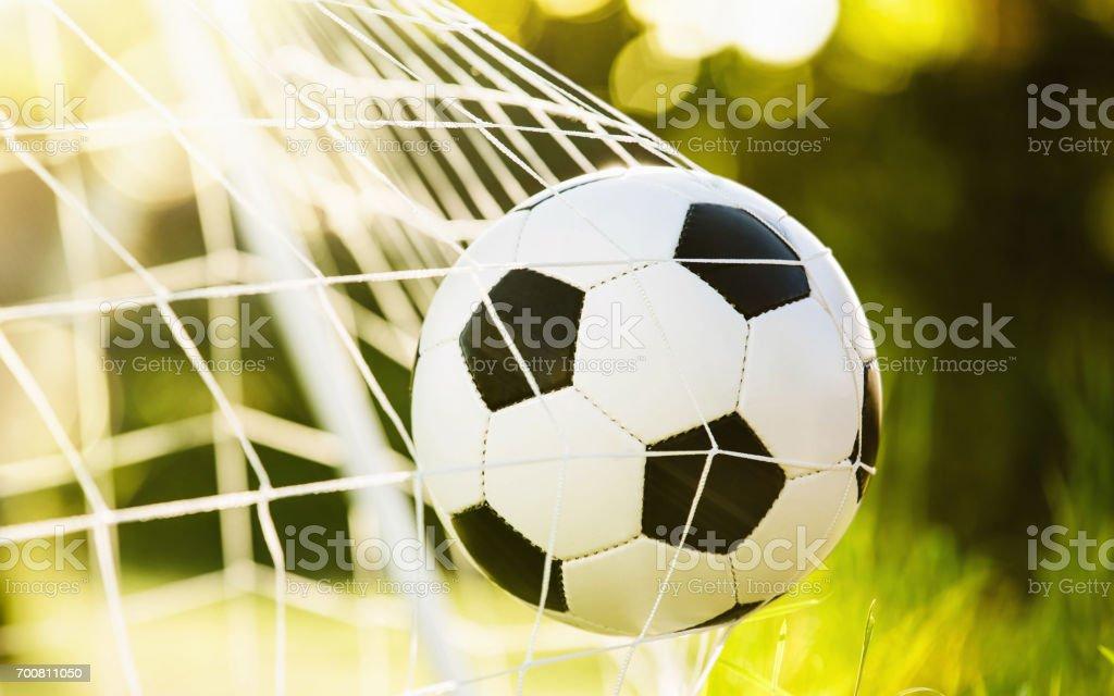 Soccer ball in goal stock photo