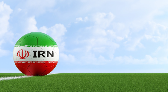 istock Soccer ball in Iran national colors on a soccer field. Copy space on the right side 1168641065