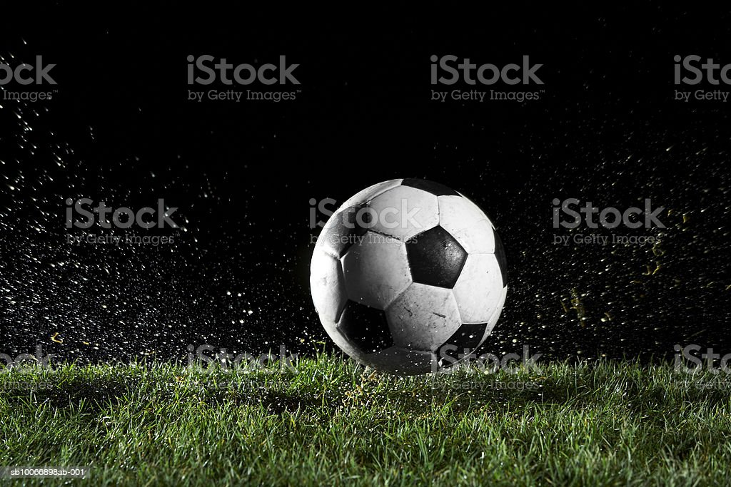 Soccer ball in motion over grass royalty free stockfoto