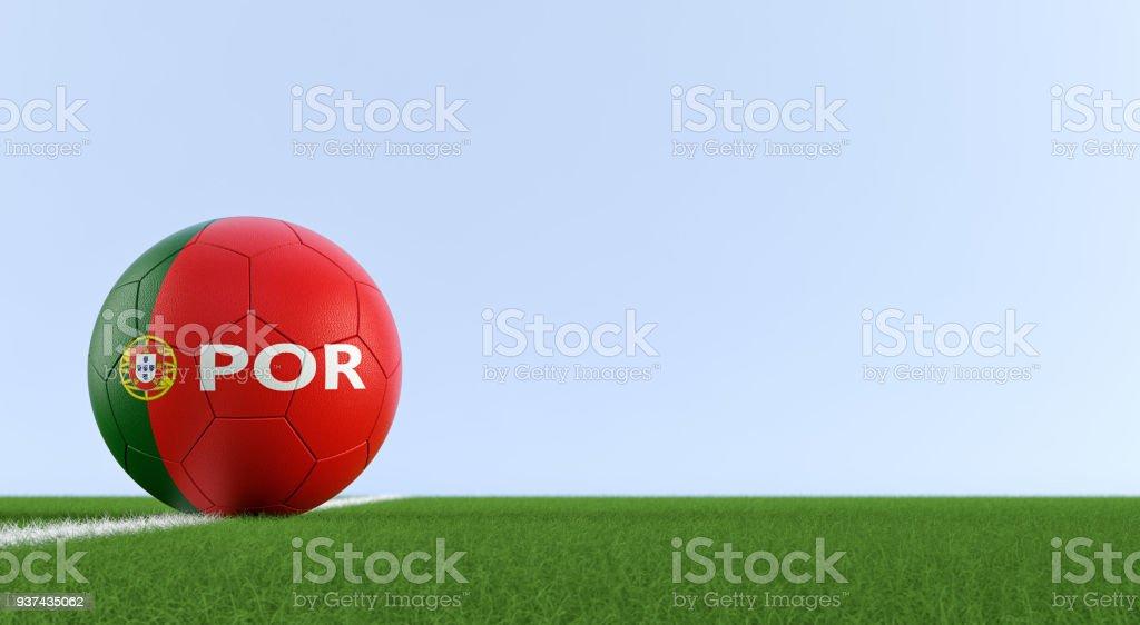 Bola de futebol em Português cores nacionais em um campo de futebol. Cópia espaço no lado direito - 3D Rendering - foto de acervo