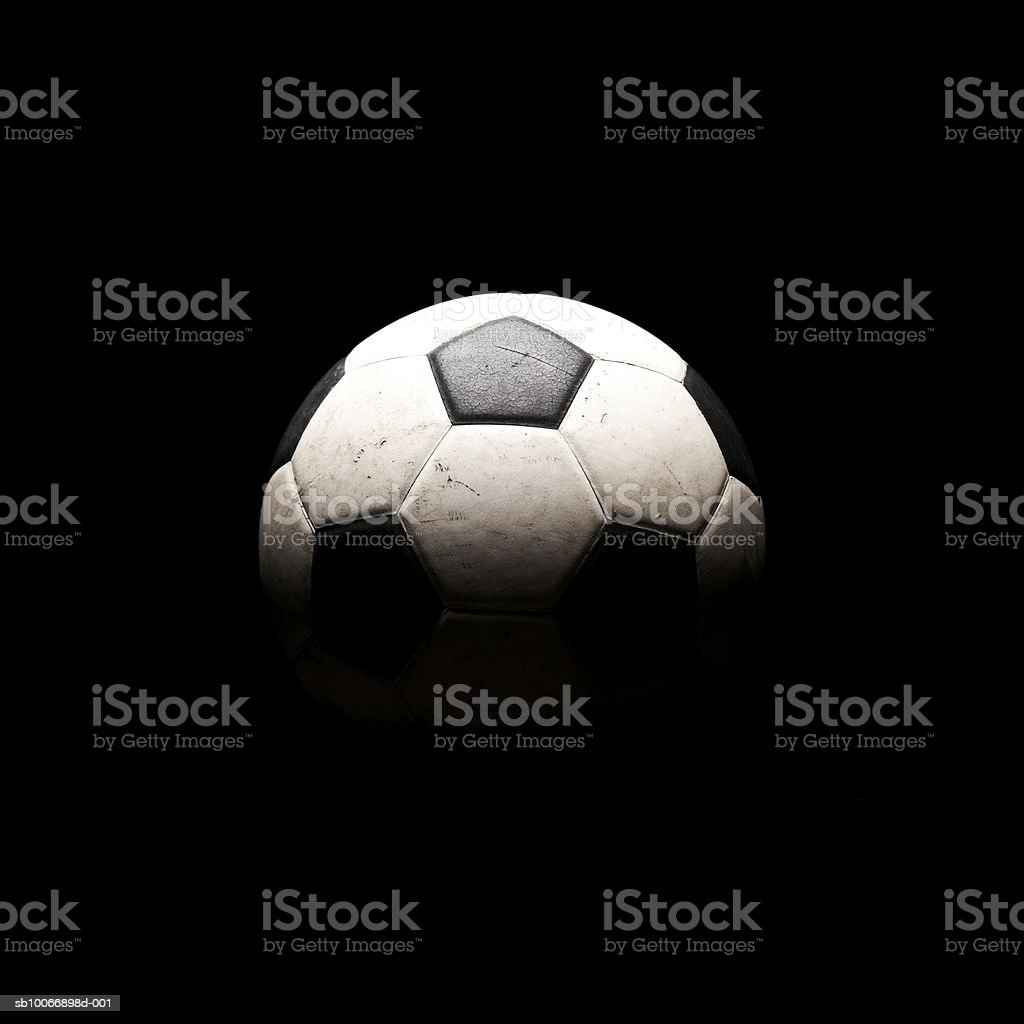Soccer ball in shadows royalty-free stock photo