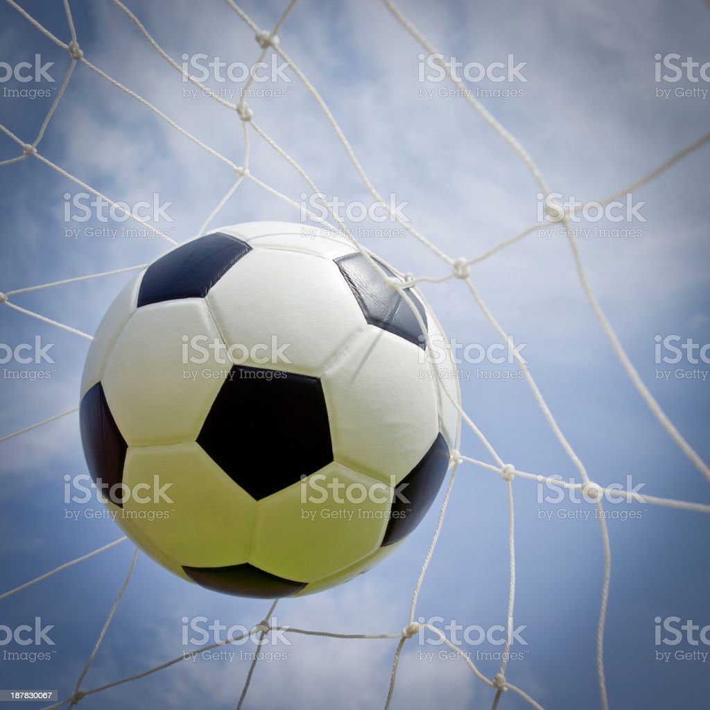 Soccer ball in the goal royalty-free stock photo