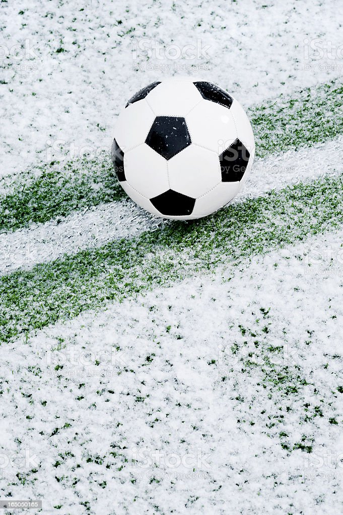 Soccer Ball in the snow royalty-free stock photo