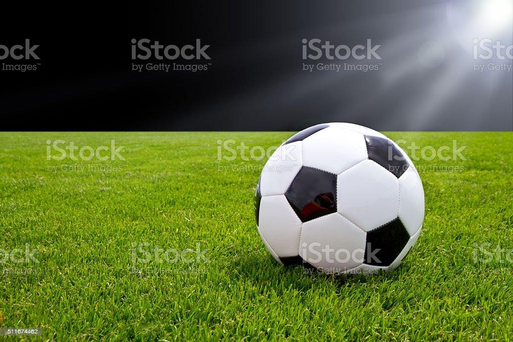 Soccer ball in the stadium stock photo