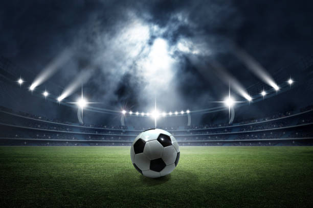 soccer ball in the stadium - soccer field stock photos and pictures