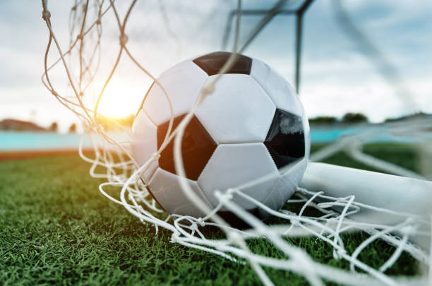 Soccer ball into the goal Soccer ball into the goal netting stock pictures, royalty-free photos & images