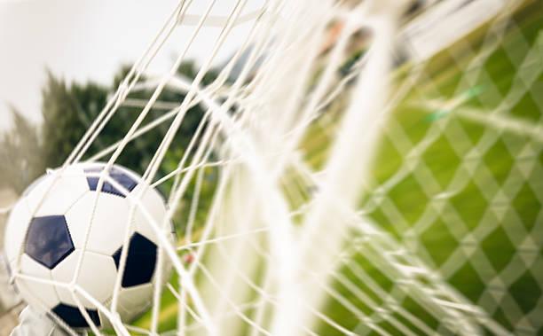 soccer ball into the net - soccer goal stockfoto's en -beelden
