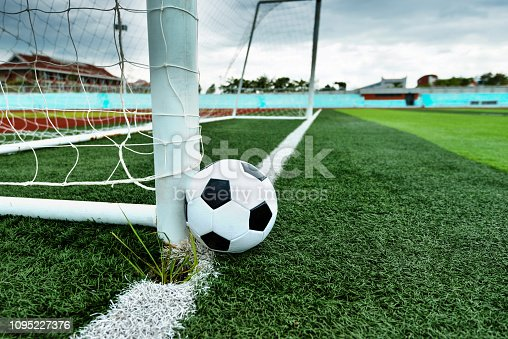 637297180 istock photo Soccer ball is outside the goal 1095227376