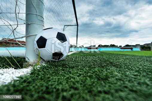 637297180 istock photo Soccer ball is outside the goal 1095227392