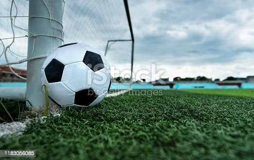 637297180 istock photo Soccer ball is outside the goal 1183056085