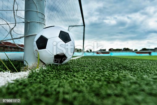 637297180 istock photo Soccer ball is outside the goal 976661512