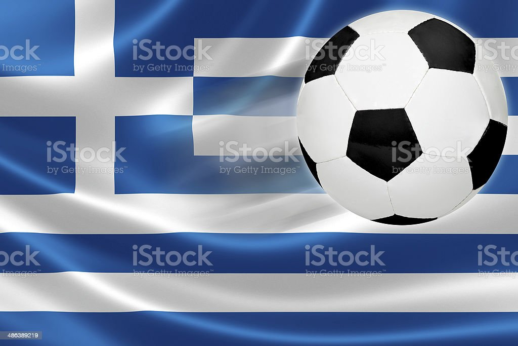 Soccer Ball Leaps Out of Greece's Flag stock photo