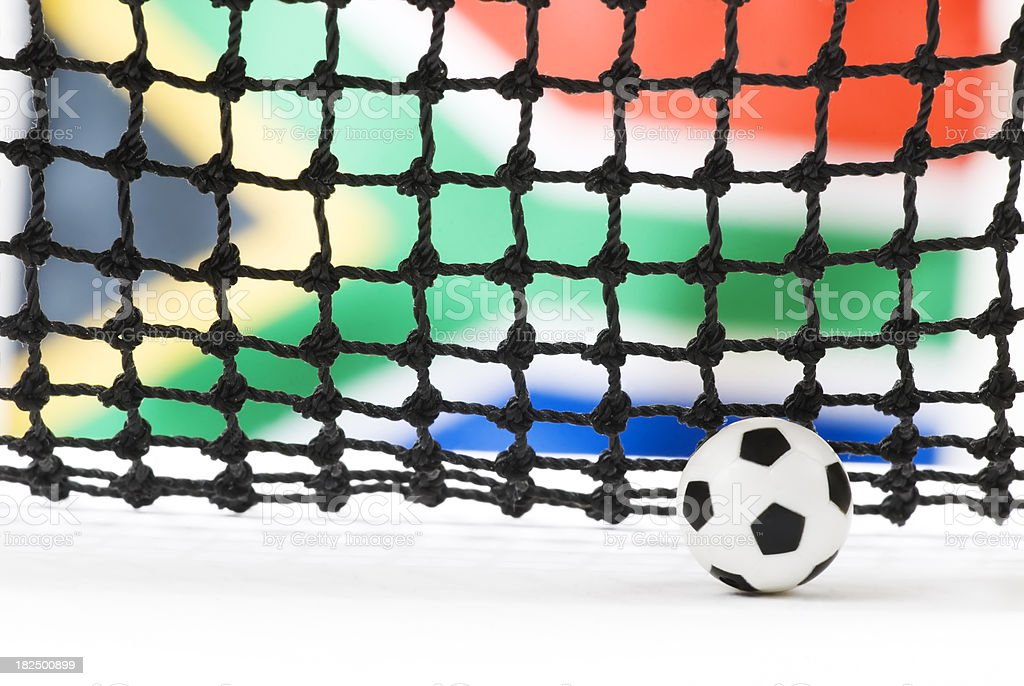 Soccer (football) ball, net and South African flag - I royalty-free stock photo