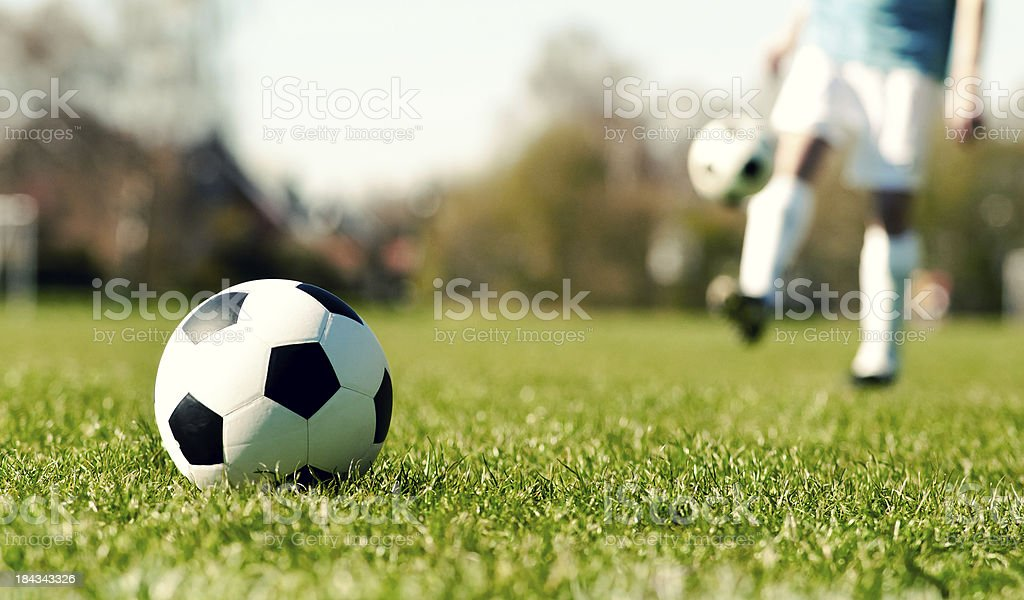 Soccer ball on a field royalty-free stock photo
