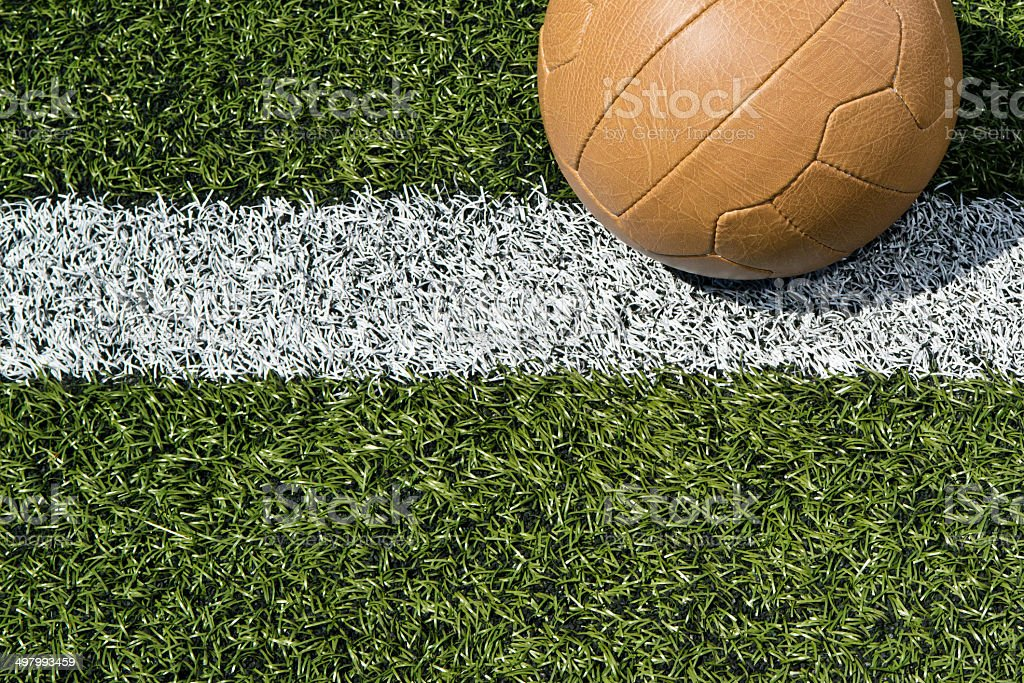 Soccer ball on a soccer field stock photo
