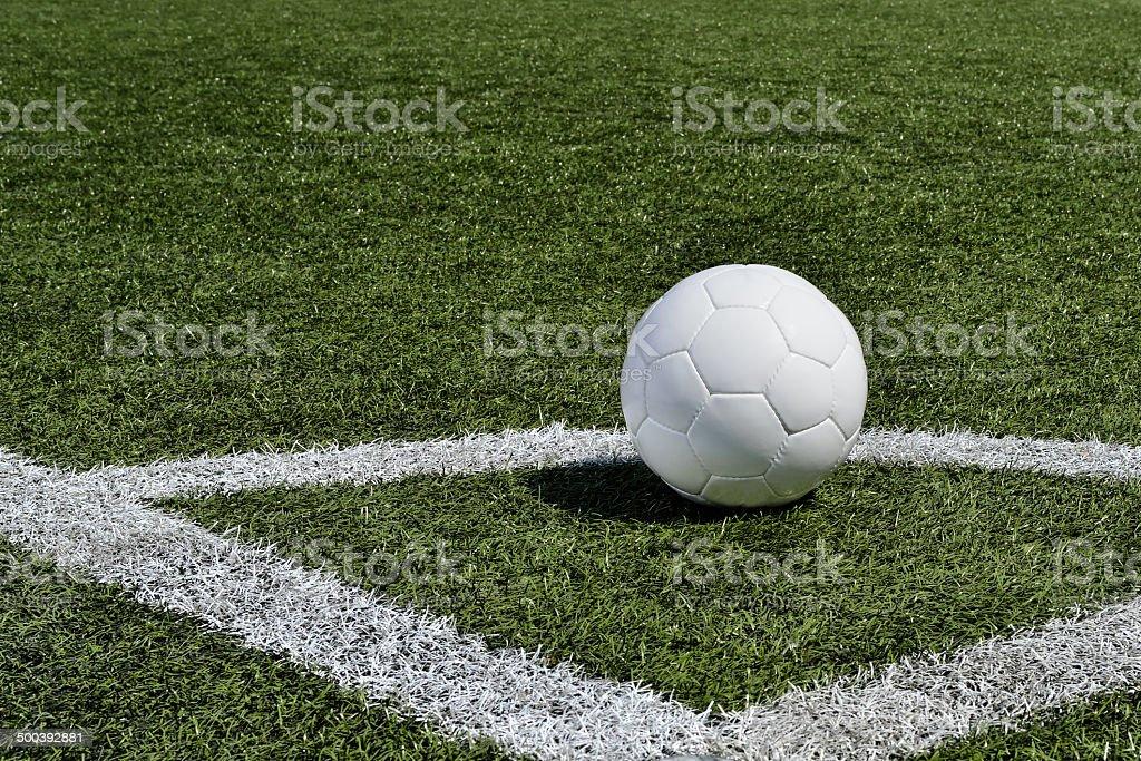 Soccer ball on a soccer field stock photo