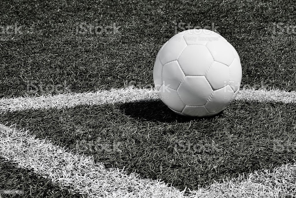 Soccer ball on a soccer field royalty-free stock photo
