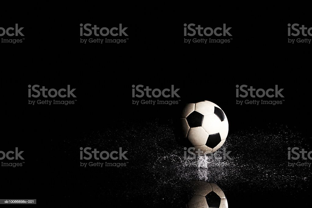 Soccer ball on black reflective surface royalty-free stock photo