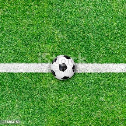 istock Soccer ball on green grass 171363180