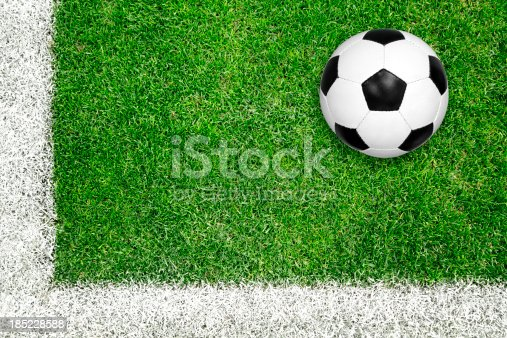 185262834 istock photo Soccer ball on green grass 185228588