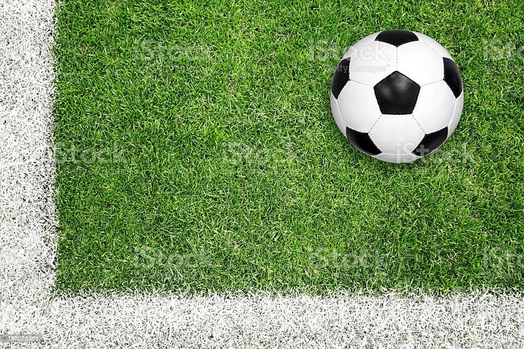 Soccer ball on green grass stock photo