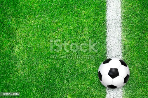 185262834 istock photo Soccer ball on green grass 185262834