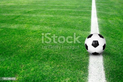 istock Soccer ball on green grass 185286400