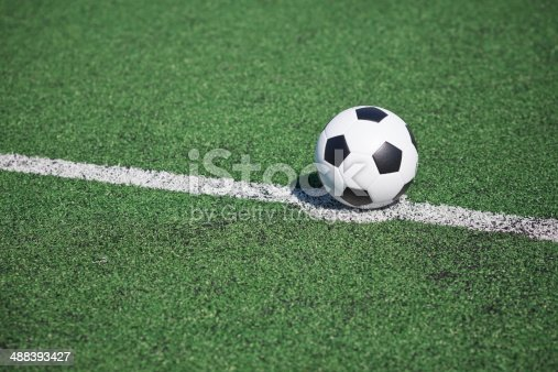 185262834 istock photo Soccer ball on green grass 488393427