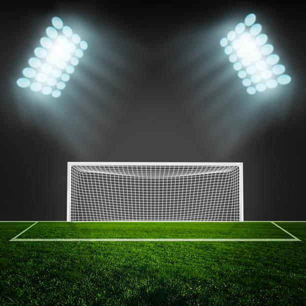 soccer ball on green stadium arena - soccer goal stockfoto's en -beelden