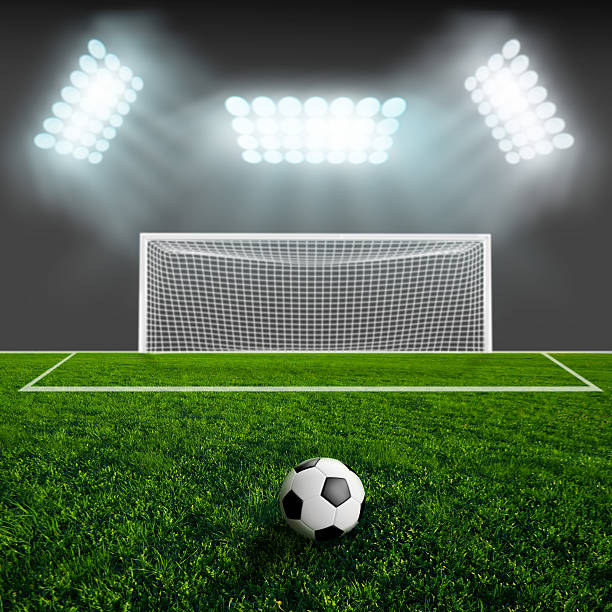 Royalty free soccer goal pictures images and stock photos istock soccer ball on green stadium arena stock photo reheart Images