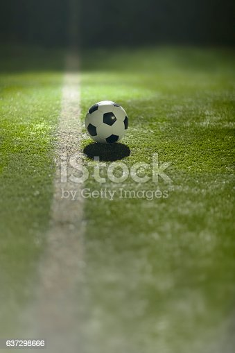 637298374istockphoto Soccer ball on sports field at boundary line 637298666