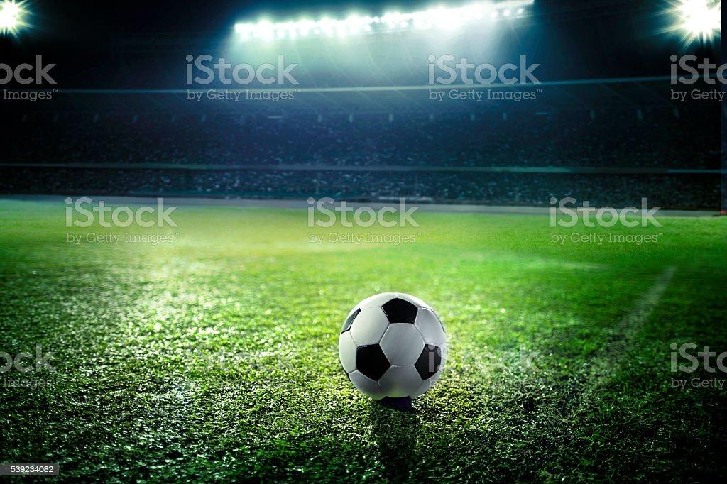 Soccer ball on sports field stock photo