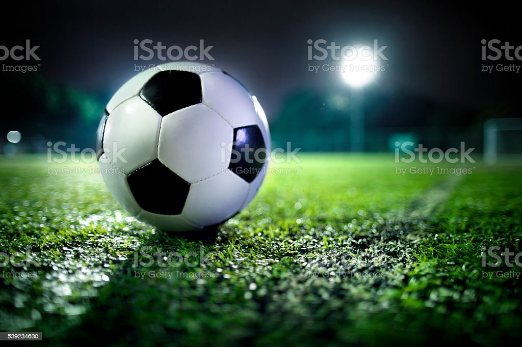 Soccer ball on sports field royalty-free stock photo