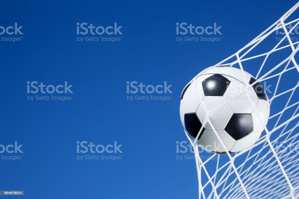 Soccer ball on the goal net stock photo