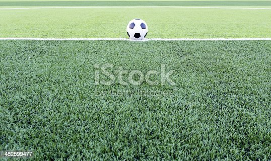 istock Soccer ball on the green field 482599477