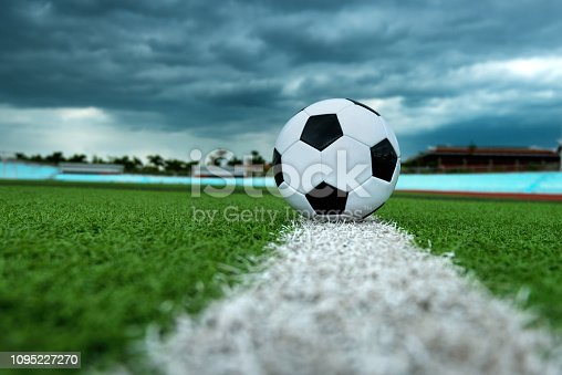 185262834 istock photo Soccer ball on white line 1095227270